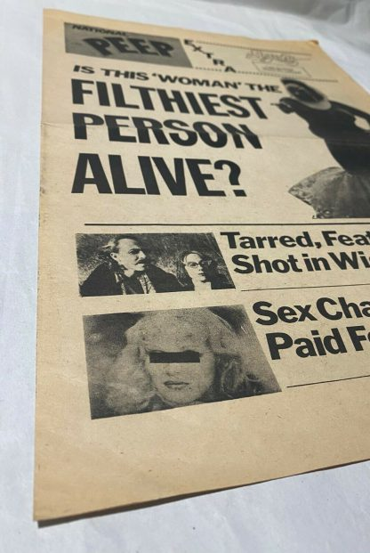 """close up of NATIONAL PEEP A one-page """"tabloid"""" published by Saliva Films"""